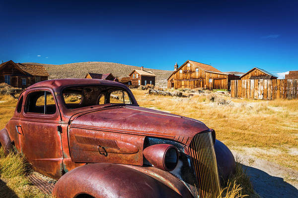 Wall Art - Photograph - Rusted Car And Buildings, Bodie State by Russ Bishop