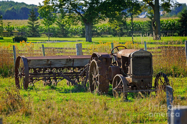 Southern Ontario Photograph - Rusty Old Mccormick Deering Tractor by Louise Heusinkveld