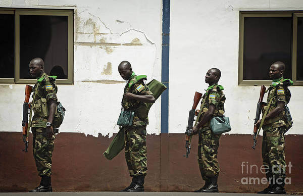 Kigali Wall Art - Photograph - Rwandan Soldiers Wait In Line To Board by Stocktrek Images