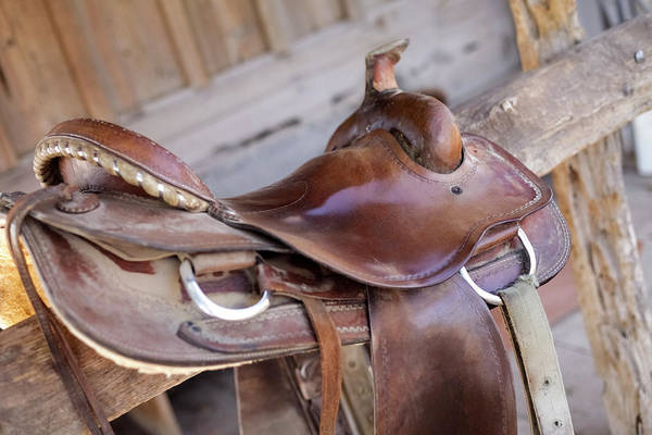 Wall Art - Photograph - Saddle Resting On The Railing, Tucson by Julien Mcroberts