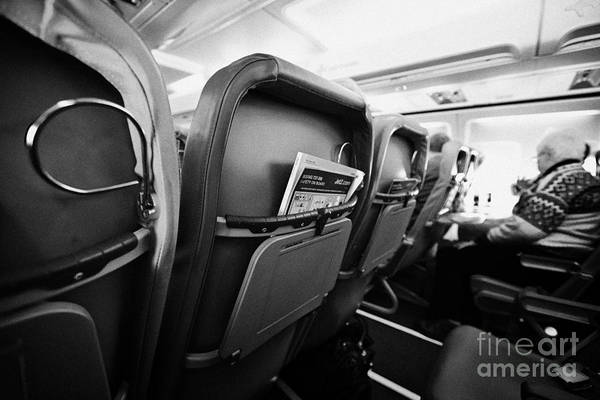 Jet2 Wall Art - Photograph - Safety Card And In Flight Magazine In Seat Pocket Interior Of Jet2 Aircraft Passenger Cabin In Fligh by Joe Fox