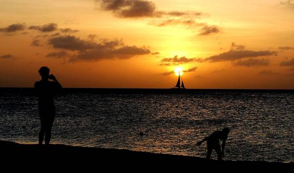 Wall Art - Photograph - Sailboat Hits Sunset At Aruba Beach by Ron Bartels