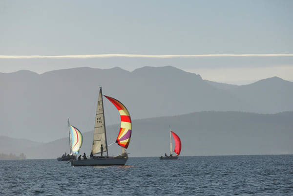 Swan Boats Photograph - Sailboats Fly Their Spinnaker by Craig Moore