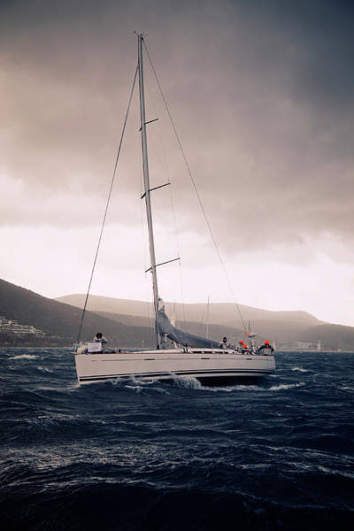 Sailing Photograph - Sailing  And Stormy Weather by Travenian