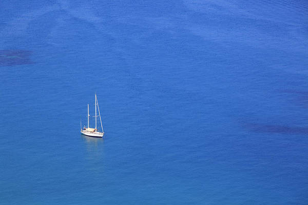 Sicily Photograph - Sailing Boat In The Blue Sea by Massimo Pizzotti