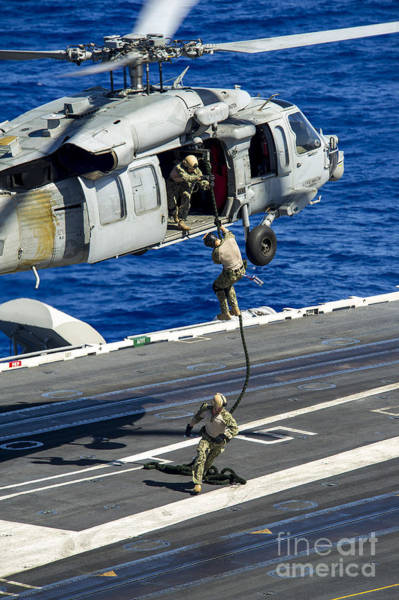 Uss George Washington Wall Art - Photograph - Sailors Conduct A Fast-rope Exercise by Stocktrek Images