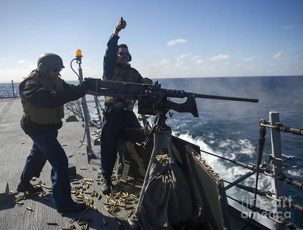 Gunfire Photograph - Sailors Fire A .50-caliber Machine Gun by Stocktrek Images