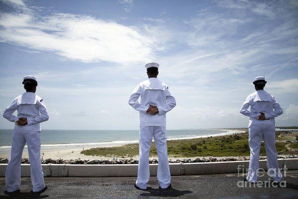 Norfolk Naval Station Wall Art - Photograph - Sailors Man The Rails As The Ship Pulls by Stocktrek Images
