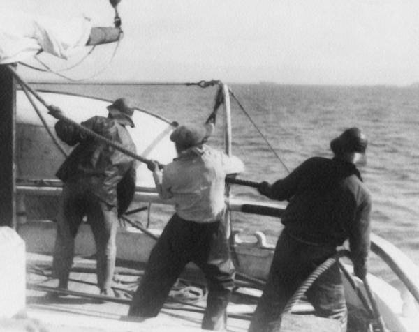 Work Boat Photograph - Sailors Pulling Rope by Underwood Archives