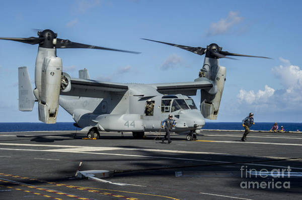 Mv-22 Photograph - Sailors Run To Safety After They Chock by Stocktrek Images
