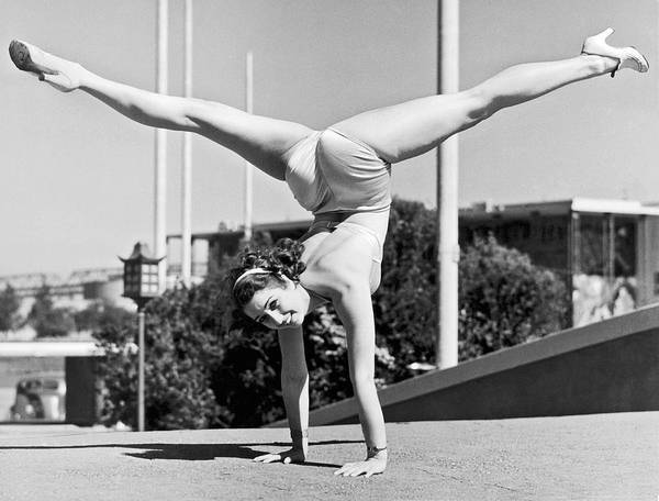Photograph - Sally Rand Combines A Hand Stand With The Splits by Underwood Archives