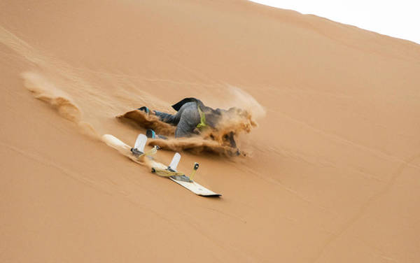 Sand-boarding The Saharan Sand Dunes, Merzouga, Morocco Art Print by Paul Biris