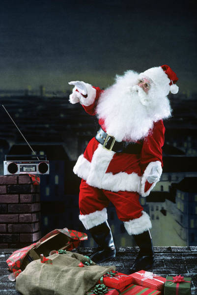 Jolly Holiday Photograph - Santa Claus Dancing On A Rooftop by Vintage Images