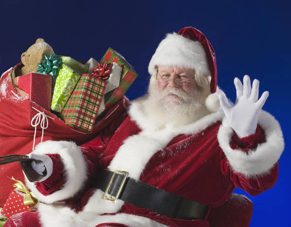 Santa Claus Next To Bag Of Toys Art Print by Tetra Images