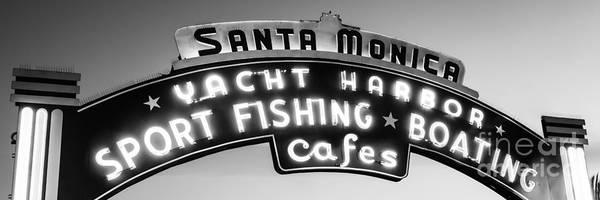 Santa Monica Pier Photograph - Santa Monica Pier Sign Panoramic Black And White Photo by Paul Velgos