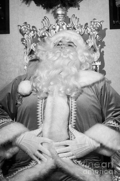 Wall Art - Photograph - Santa Sitting On His Throne Laughing With Hands On Belly In Grotto Set Up by Joe Fox