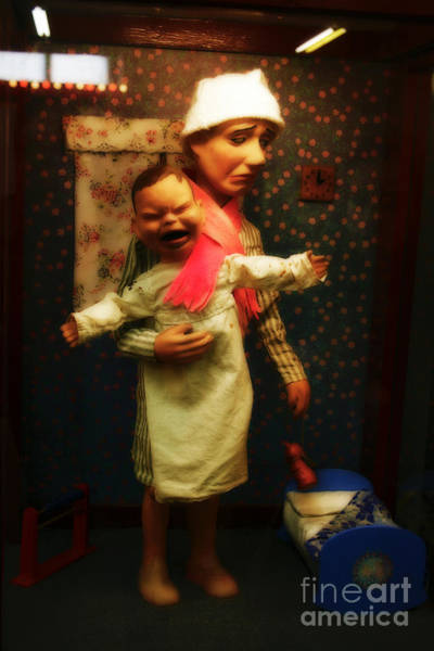 Photograph - Scary Old Puppet Holding Baby by Doc Braham
