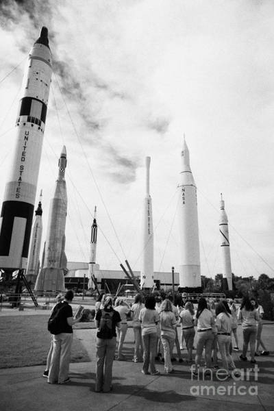 Wall Art - Photograph - school group taking guided tour of the rocket garden at Kennedy Space Center Florida USA by Joe Fox