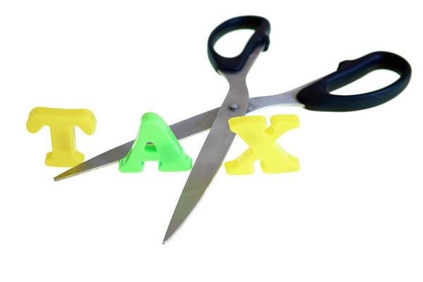 Wall Art - Photograph - Scissors Cutting The Word Tax by Ian Hooton/science Photo Library
