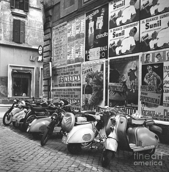 Wall Art - Photograph - Scooters And Motorcycles On A Street In Rome 1955 by The Harrington Collection