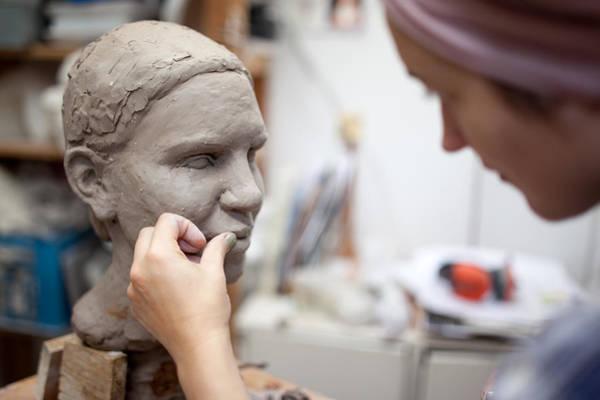 Sculptor Working On Head Sculpture Art Print by Guido Mieth