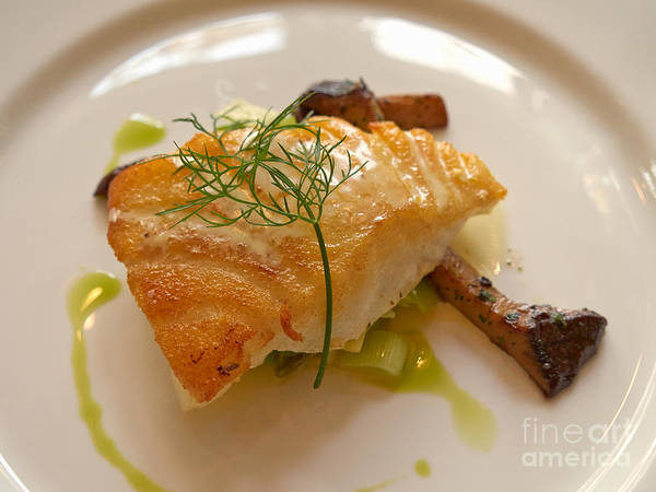 Wall Art - Photograph - Sea Bass With Trumpet Mushrooms Leeks And Absinthe Cream by Louise Heusinkveld