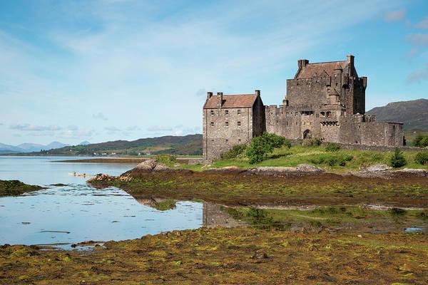 Wall Art - Photograph - Sea Kayakers, Eilean Donan Castle, Loch by Holger Leue