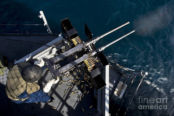 Mounted Shooting Photograph - Seaman Fires Twin .50 Caliber Machine by Stocktrek Images