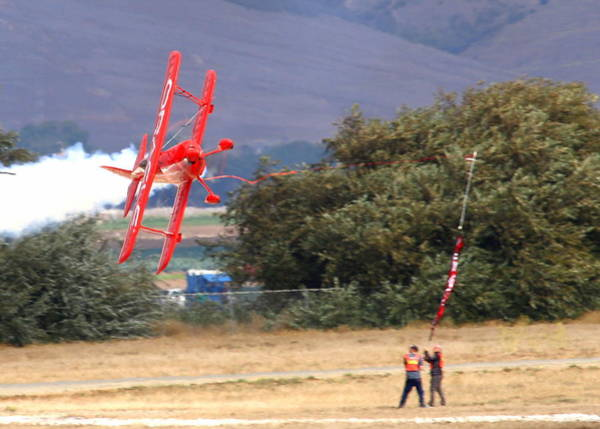 Photograph - Sean Tucker Cutting The Ribbon At Salinas Air Show Ksns by John King