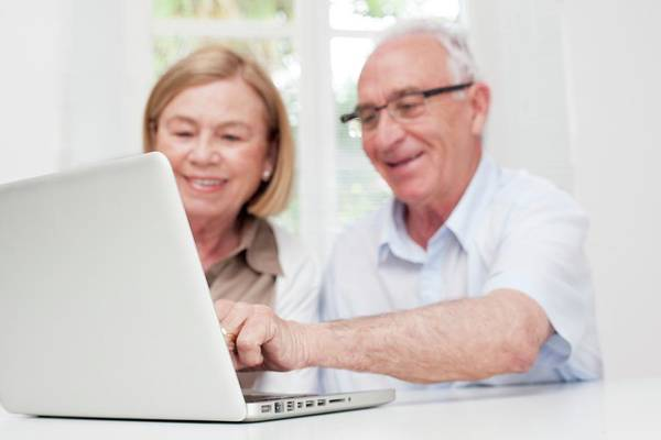 Technological Wall Art - Photograph - Senior Couple Using Laptop by Science Photo Library
