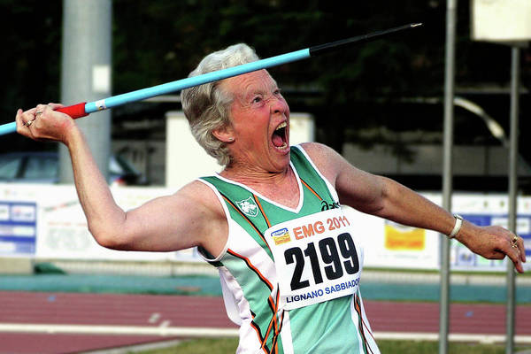 Javelin Photograph - Senior Female Athlete Throws Javelin by Alex Rotas