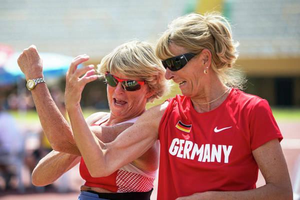 Joyful Photograph - Senior Female Athletes Compare Biceps! by Alex Rotas