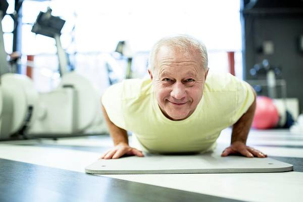 Self Confidence Photograph - Senior Man Exercising In Gym by Science Photo Library