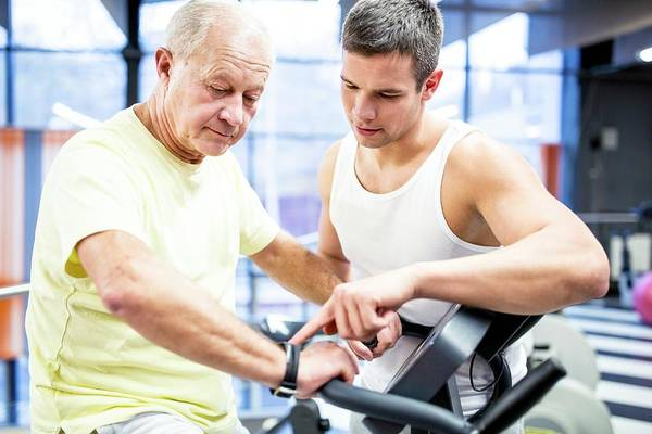 Senior Photograph - Senior Man Exercising With Trainer by Science Photo Library