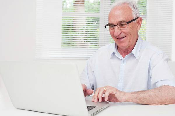 Technological Wall Art - Photograph - Senior Man Using Laptop by Science Photo Library