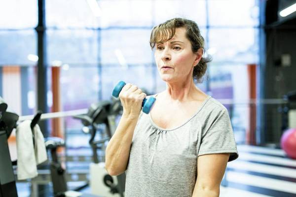 Self Confidence Photograph - Senior Woman Holding Dumbbell by Science Photo Library