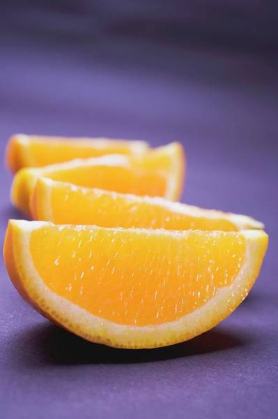 Wall Art - Photograph - Several Orange Wedges by Foodcollection