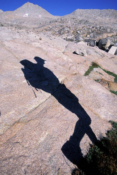 Wall Art - Photograph - Shadow On A Rock Of A Backpacker by Corey Rich