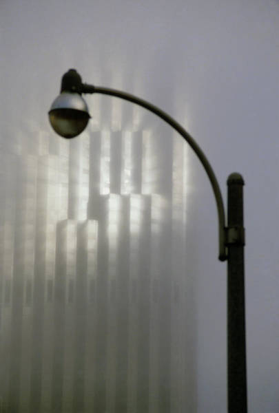 Shaft Wall Art - Photograph - Shaft Of Sunlight In Fog With Streetlamp by David Parker/science Photo Library
