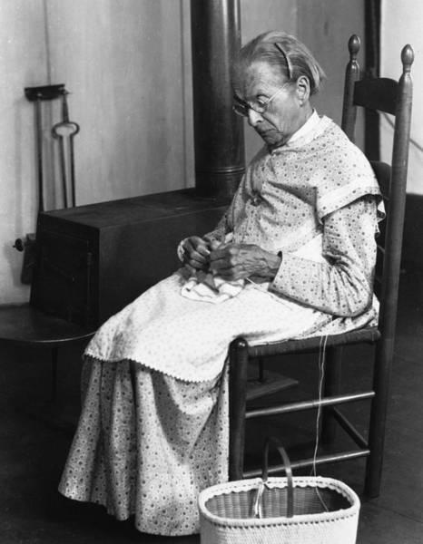 Wall Art - Photograph - Shaker Woman Knitting by Granger