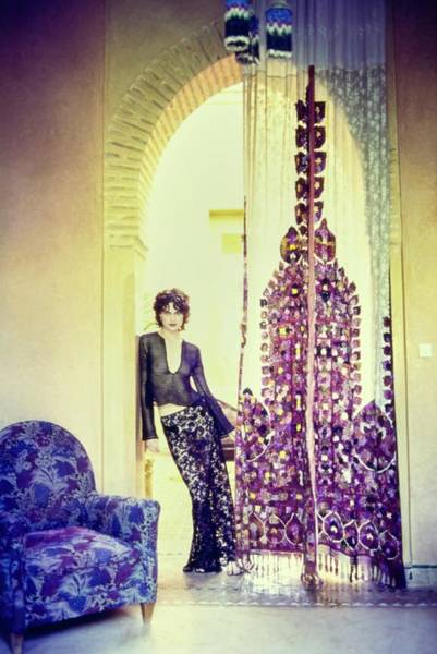 Wall Art - Photograph - Shalom Harlow Standing Under Arch In Morocco by Arthur Elgort