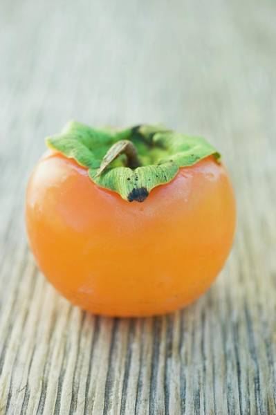 Wall Art - Photograph - Sharon Fruit On Wooden Background by Foodcollection