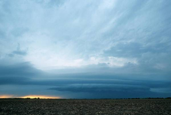 Shelf Cloud Photograph - Shelf Cloud Forming Over Fields by Jim Reed Photography/science Photo Library