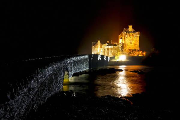 Photograph - Shine Like It Does - Golden Eilean Donan Castle by Mark Tisdale