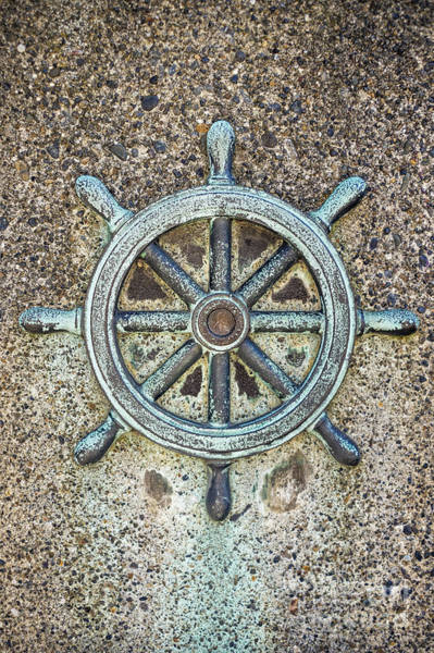 Photograph - Ships Steering Wheel Decoration On Concrete Wall by Bryan Mullennix