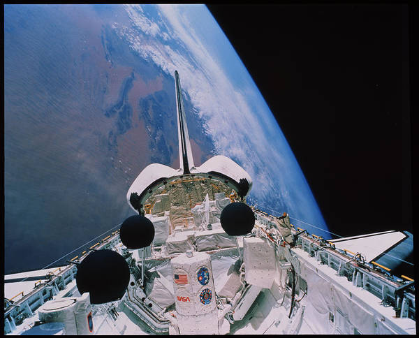 Space Shuttle Photograph - Shuttle In Orbit by Nasa/science Photo Library