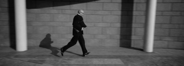 Wall Art - Photograph - Side Profile Of A Businessman Running by Panoramic Images