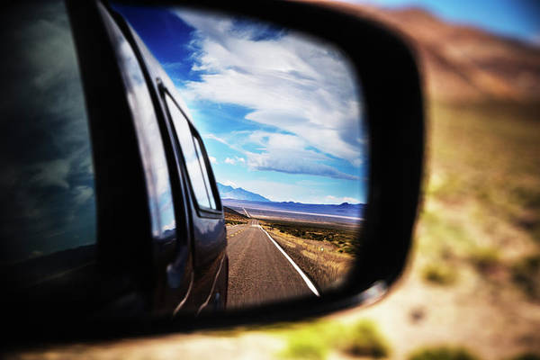 Fallon Wall Art - Photograph - Side View Mirror Of Car Driving On Road by Ron Koeberer