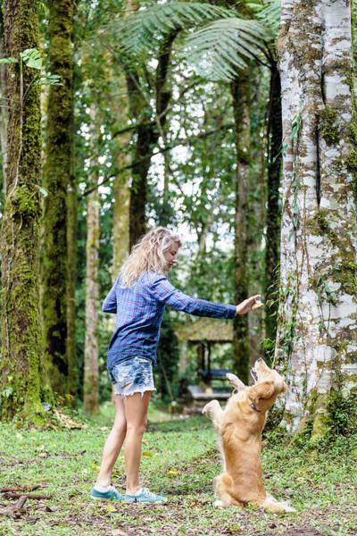 Wall Art - Photograph - Side View Of Blonde Woman Teaching Dog by Konstantin Trubavin