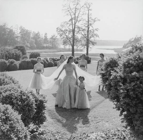 Wedding Photograph - Sidney Bacon In Garden With Her Bridesmaids by Horst P. Horst